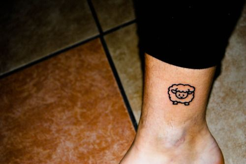 A simple and so cute tattoo on ankle. It is a sheep tattoo