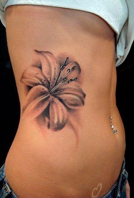 tattoos for women | PRETTY 3D REALISTIC FLOWER TATTOO ON SIDE BODY - Tattoosgallaries #tattoosforwomenonside