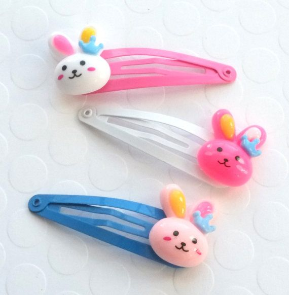 Bunny hair clips, perfect for a sweet little girl! Set of two snap hair clips, you choose the color Bright Pink bunny white clip White bunny pink clip Light Pink bunny on blue clip  Clips measure 2 long (50mm)  ~ All my snap clips come on a display card  ❤️ ❤️ ❤️ FOLLOW ME ❤️ ❤️ ❤️  Save 15% off your first purchase, like one link below and send me a message! www.facebook.com/cherrybombcreative www.instagram.com/cherrybombcreative www.pinterest.com/cherrybombcreat/