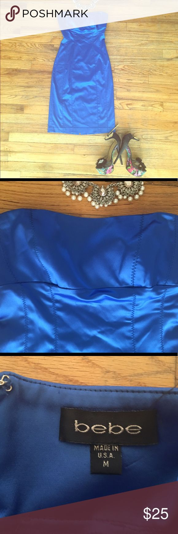 Vibrant blue Bebe club or cocktail dress 😍 The pics don't do it justice! I got so many compliments on this dress at the club in Las Vegas. It's a really vivid royal blue with some shine to the fabric- perfect for going out. It's strapless, but the cups are molded giving it just enough shape and support. Seriously, this dress hugs ever curve and makes you feel sexy af. There are a couple of tiny pull in the fabric on the back, as pictured in the 4th photo. Totally not noticeable on. In this…