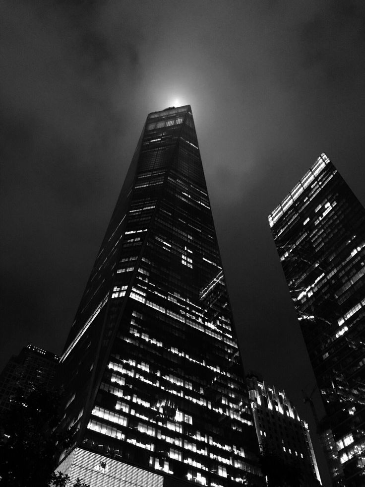 This is what the One World Trade tower looks like from below on a foggy night