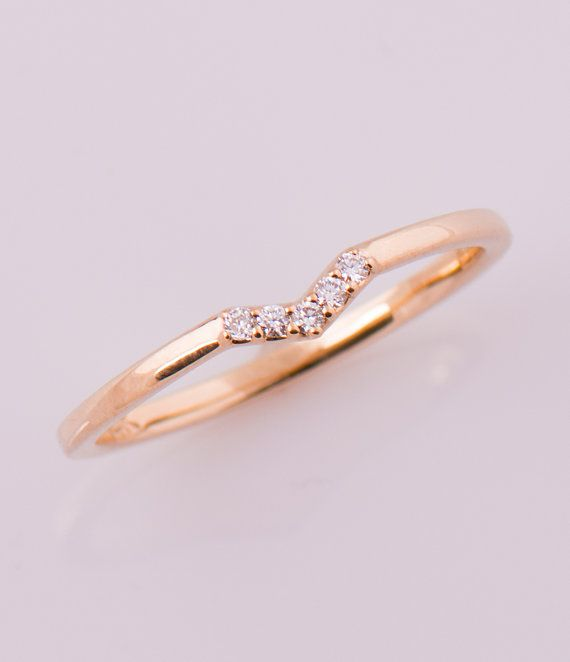 Small V shaped, five stone diamond ring in 14K rose gold, set with a clear diamonds. The ring surface is elegant and rounded shape while the sides are straight and comfortable for more stackable rings to wear. The inside of the ring is flat to make it steady and comfortable while it sits on the finger. Picture # 4