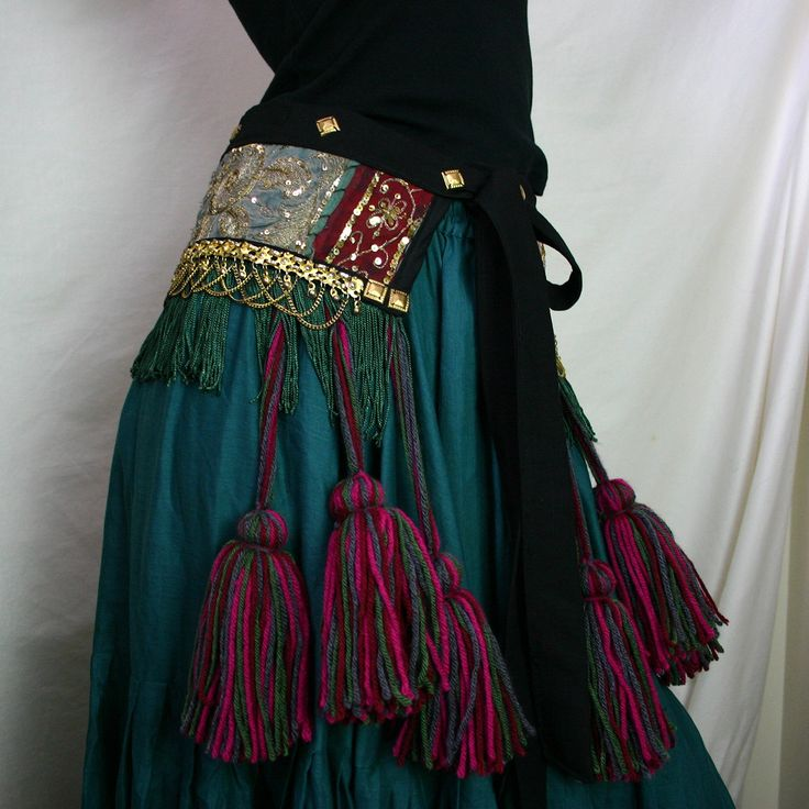Jewel-toned Indian Embroidered Patchwork Tribal Fusion/Tribaret Belly Dance Belt with Fringe, Pom Poms and Coin Band.. $120.00, via Etsy.