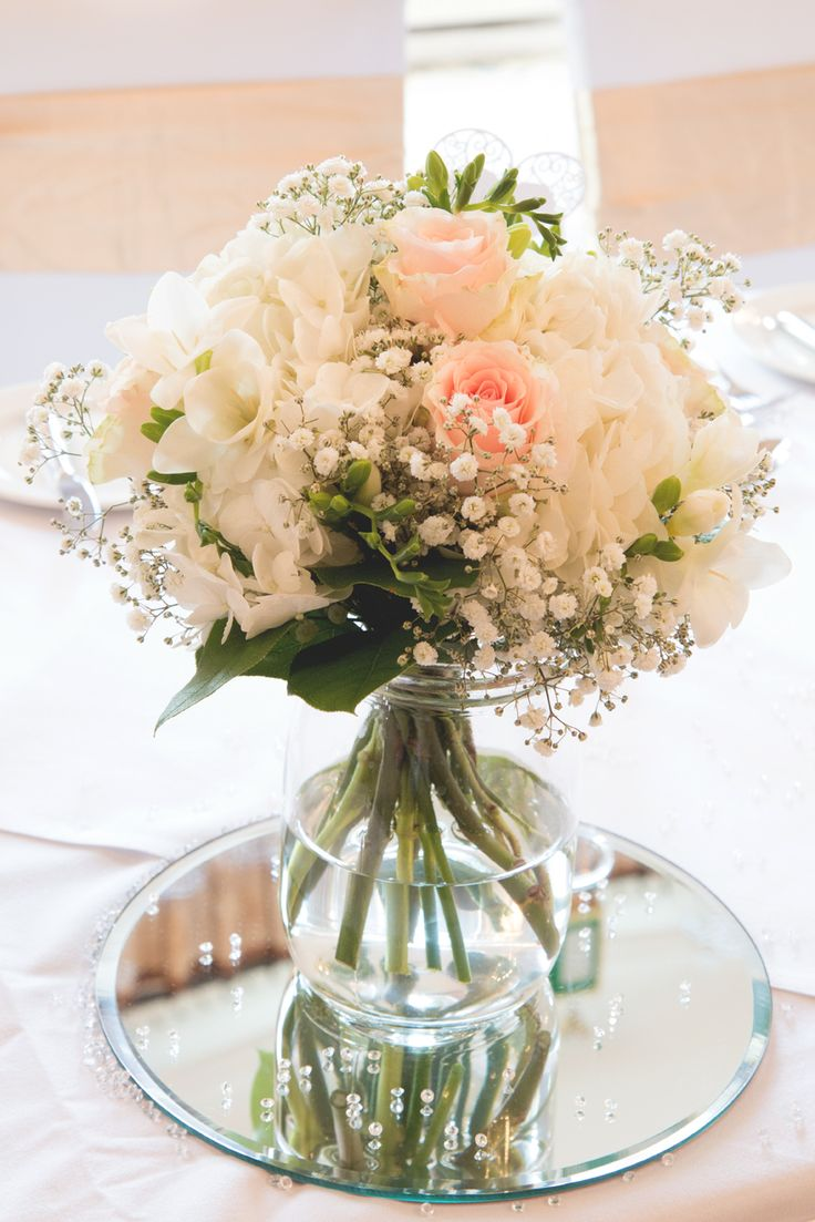 gorgeous wedding table centrepiece. peach and ivory. roses. gypsophila. pink.