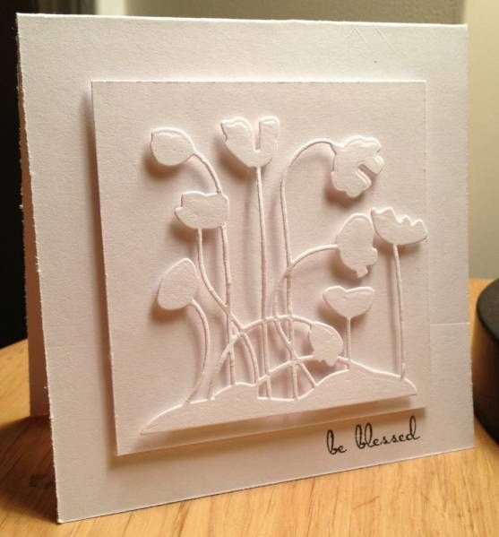 handmade card ... all white ... die cut flowers ... luv they way the light and shadow adds to the dimension with popped up die cuts ...