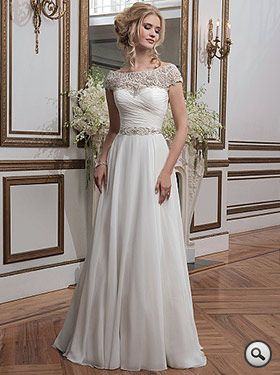 Justin Alexander 8799 // Flowing gown in chiffon with a Portrait neckline of beaded embroidery. Matching waistband at the natural waistline. A-line skirt, button covered zip-up back and a Chapel length train.