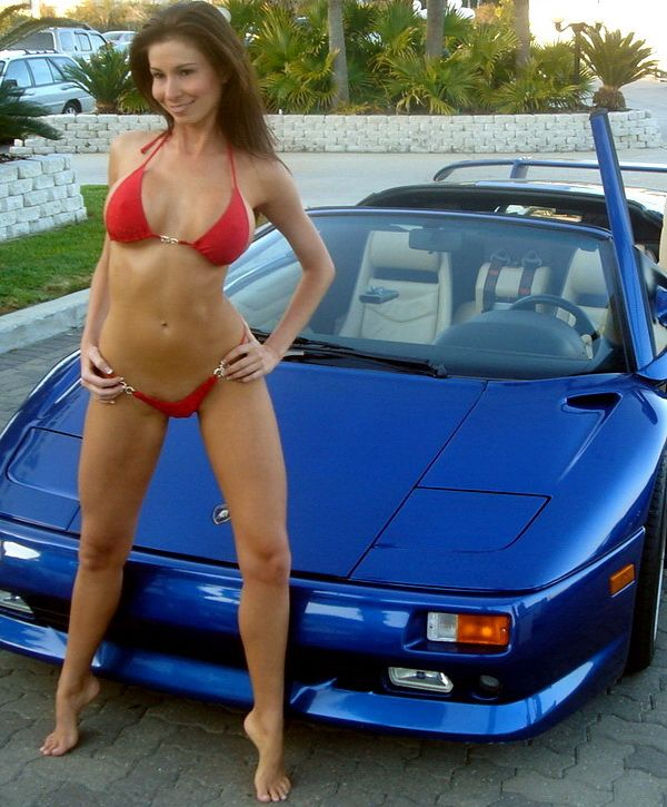 Naked girl posing with car