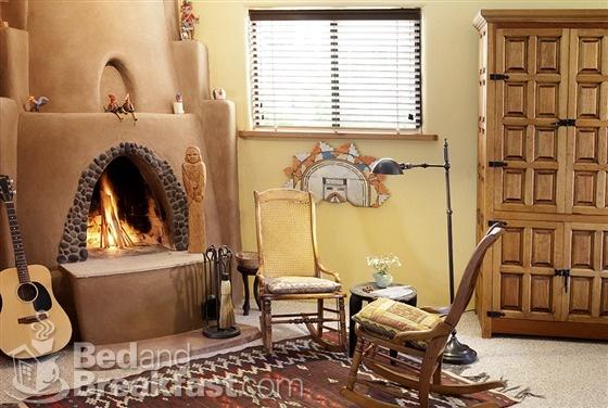 Leghorn casita 39 s kiva fireplace adobe kiva style for Kiva style fireplace