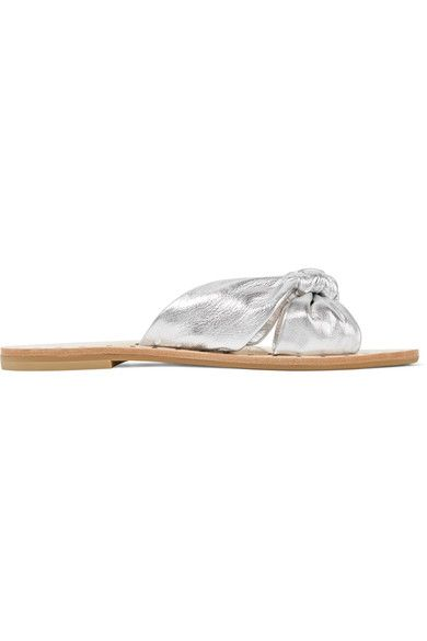 """Our Summer collection was inspired by well-worn favorites like knotted tee shirts and perfectly broken-in denims, farmer's market florals and sparkly stones on bronzed skin,"" says Loeffler Randall. Part of the lineup, these 'Lucia' slides have knotted metallic leather straps and studding that frames the insole. The silver hue will work with countless outfits - try yours with denim."
