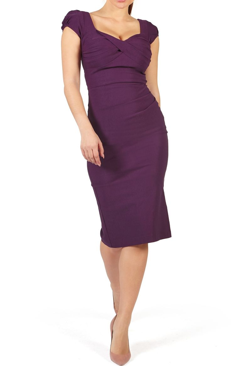 Nigella Dress in aubergine purple plum. Bodycon Dress as worn by Nigella Lawson & Susan Sarandon: The Nigella Dress draws on the vintage charm and feminine glamour of old Hollywood. This sexy, bombshell of a dress hugs your curves, flattering ample bosoms without revealing too much cleavage, and is guaranteed to draw compliments. Named after celebrity fan, Nigella Lawson, who famously wore this dress in red to rapturous acclaim, this expertly crafted retro 1950's inspired style is the…
