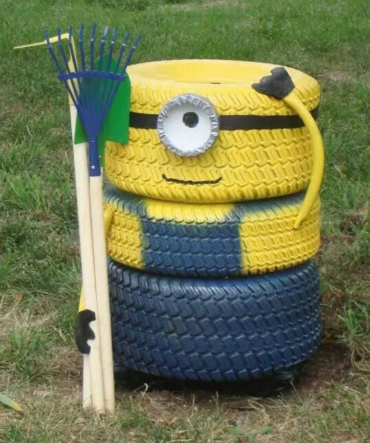 Minion from lawn mower tires, inner tube, rake, garden hose, and paint