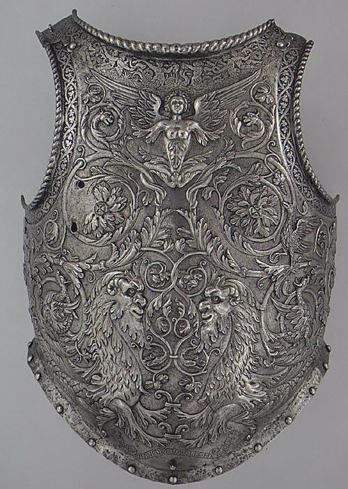 Italian (Milan) steel breastplate, c1545. Formerly part of a parade armor, this is the only signed work of Giovanni Paolo Negroli, a cousin of the more famous Filippo Negroli. Now bright, the breast plate's surface probably was originally russet-colored and the raised and etched areas were gilded. (Metropolitan Museum of Art)