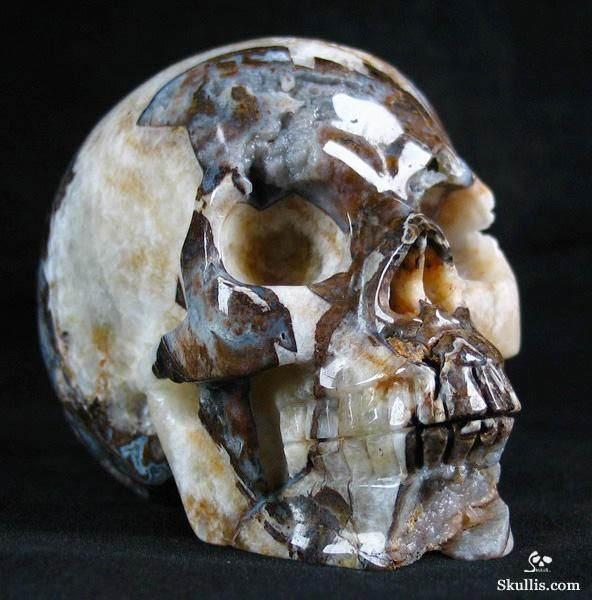 Crystal skull carved from a lace agate geode stone