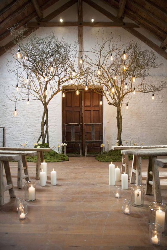Bulbs hung from trees in chapel. Amazingly romantic wedding inspiration. Giulia Miller. Romantic Wedding Lighting Ideas