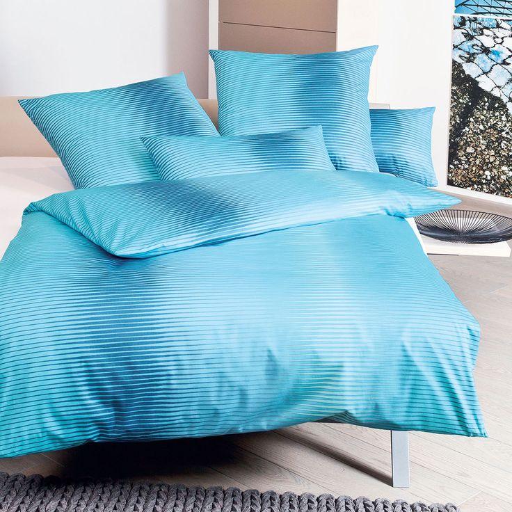 Janine Interlock Feinjersey Bettwäsche Carmen 53021-02 aqua in reiner Baumwolle. Moderne Farben und das wellenartige quer gestreifte Muster machen die Bettwaren zum traumhaften Blickfang. Mit einer natürlichen Elastizität verwöhnt das Material. #bettwäsche #bedding #beddingset #modern #blau #blue #türkis #turquoise #stripes #streifen #bed #schlafzimmer #bedroom #sleep #schlafen #sleeping #träumen #dreaming  www.bettwaren-shop.de
