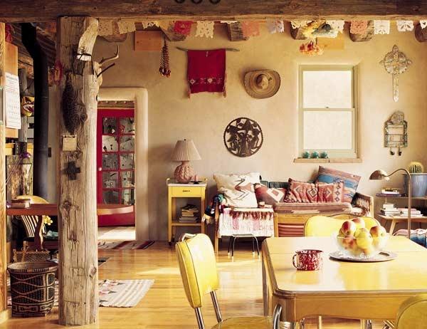 Rustic boho home. Exposed beams, retro yellow dining setting, global furnishings. Beautimus.