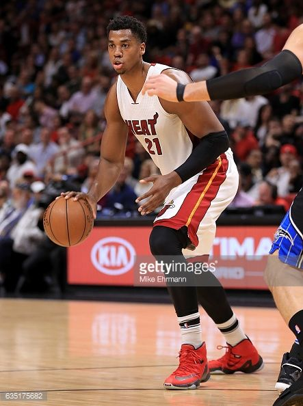 News Photo : Hassan Whiteside of the Miami Heat dribbles...