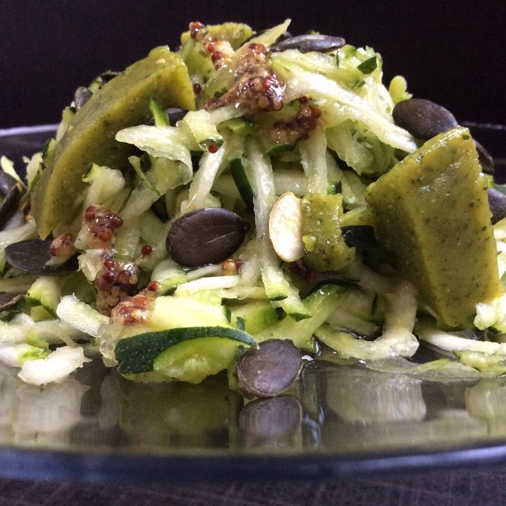 Zucchini salad with mustard and olive oil sauce, pumpkin seed and zucchini cheese