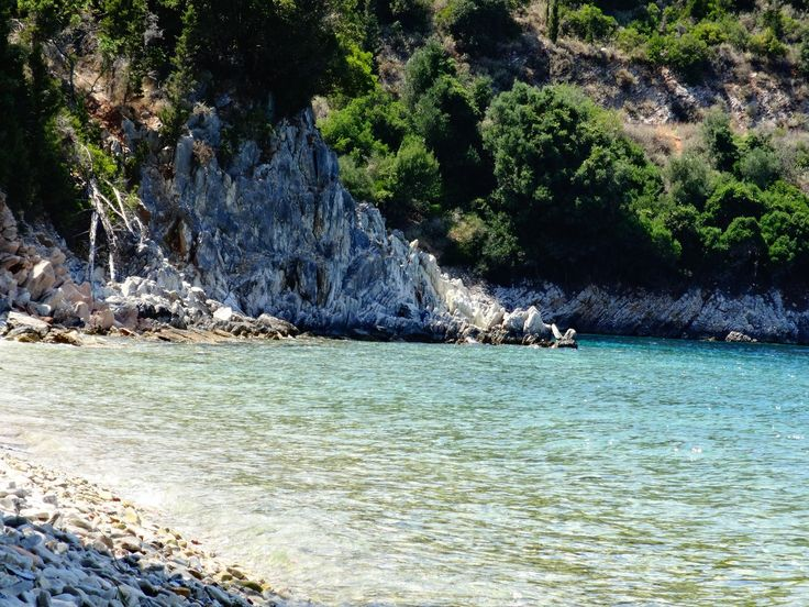 Plakoutses is a quiet and isolated beach in Kioni, Ithaca, with blue waters and olive trees that reach the sea. #Greece #Ithaca #Terrabook #GreekIslands #Travel #GreekIslands #Travel #GreeceTravel #GreecePhotografy #GreekPhotos #Traveling #Travelling #Holiday #Summer #GreeceTravel #GreecePhotografy #GreekPhotos #Traveling #Travelling #Holiday #Summer
