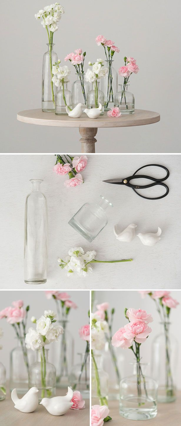 DIY Glass Bottle Set centrepiece | Confetti.co.uk | #wedding, #DIY | Bird | Pink and White Carnations