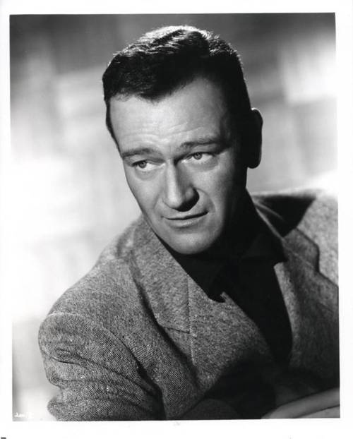 John Wayne (born Marion Robert Morrison)  was an American film actor, director and producer. Wayne was among the top box office draws for 30 years and is the highest grossing film star of all time. An enduring American icon, he epitomized rugged masculinity and is famous for his demeanor, including his distinctive calm voice, walk, and height. Born: May 26, 1907. Died: June 11, 1979 age 72 from stomach cancer. Married: Josephine Alicia Saenz, Esperanza Baur, Pilar Pallete. Father to 7…