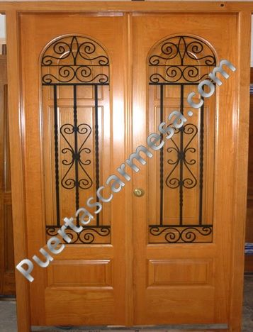 Puerta calle dos hojas medio punto ventanillo y reja for Puertas de madera baratas