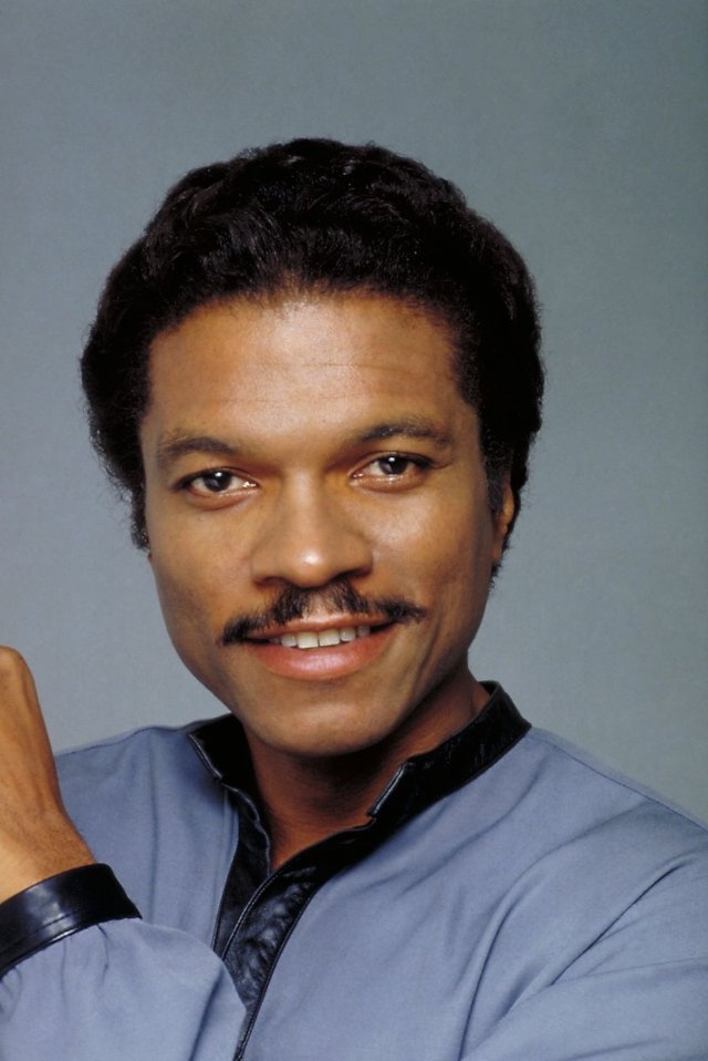 """William December """"Billy Dee"""" Williams, Jr. (born April 6, 1937) is an American actor, artist, singer, and writer. He has a twin sister, Loretta, and grew up in Harlem, where he was raised by his maternal grandmother while his parents worked at several jobs. Williams graduated from the Fiorello H. LaGuardia High School of Music & Art in Manhattan, where he was a classmate of Diahann Carroll."""
