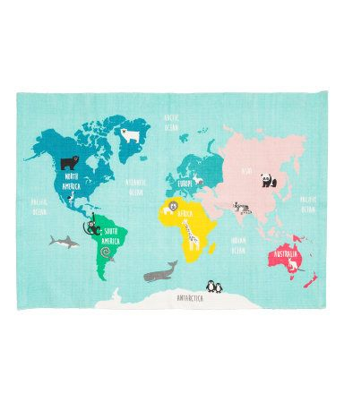 White/animals. Rectangular rug in cotton fabric with a printed world map motif on upper side. Non-slip protection at back.