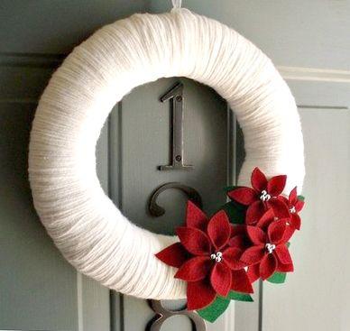 White yarn and poinsettias. Beautifully simplistic.