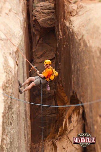 Rappelling into the exciting canyons and chasms around Moab on the Moab Adventure Center's Ephedra's Grotto Canyoneering trip! #Utah #Adventure #vacation