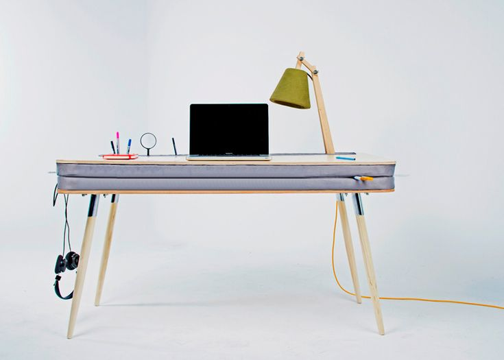 """Russian designer Anna Lotova slotted two layers of foam beneath the surface of this wooden desk to create squishy spaces for storing stationery and other objects. Named ""Oxymoron Desk"", the piece combines two contrasting materials for its tabletop;  two thick layers of upholstered foam are sandwiched between a pair of plywood sheets with curved edges."" / really cool ! I want it !"