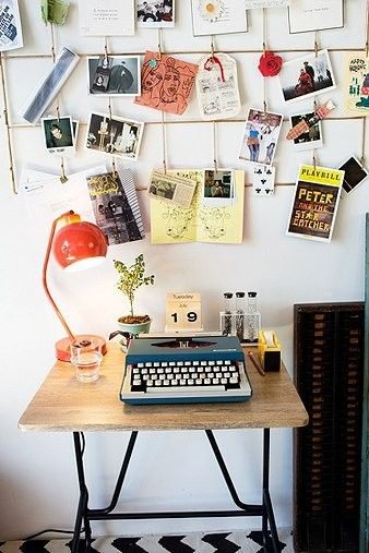 Now this would be my perfect writing space (but with a bigger desk) love the typewriter and polaroid pics!