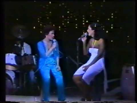 GAL COSTA TV Special, Brazil, 1981, with a very special guest. This clip is almost too good to be true. Not only do we have one of the finest artists in the history of Brazilian popular music at the height of her awesome powers, but then, amazingly, steps onto stage the legendary Elis Regina for duets and solos. Look at the faces in the audience; this is not mere entertainment but total adoration, religious ecstasy with real goddesses to the fore. Bless Youtube. (KevinR@Ky)