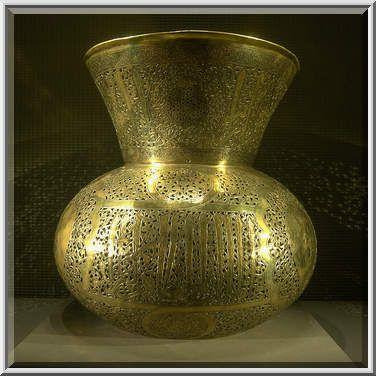 Pierced metalwork of brass mosque lamp (Damasqus, c. 1277) on display in Museum of Islamic Art. Doha, Qatar