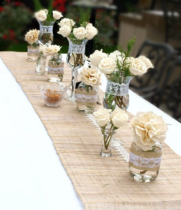 Cream Roses Mixed with Coffee Filter Flowers Table Decor- the coffee filter flowers would look cool in vases like these