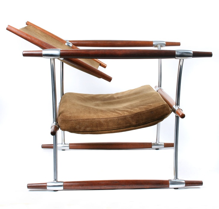 1960's.    Jens Quistgaard Rosewood and Chrome Chair for Richard Nissen. Chair has solid rosewood spokes fit into chrome stretchers that support a suede sling. The chair is held together by tension and has no screws or bolts. Denmark.1960S