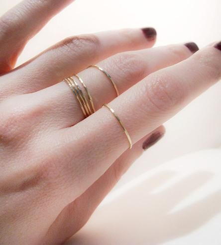 Whether you opt to stack these shimmering gold bands all together, or spread 'em across a finger or two, they're a lovely addition to any outfit.
