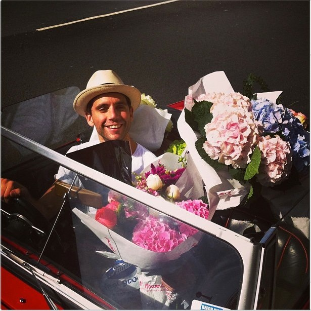 Mika, a tiny car, and big flowers