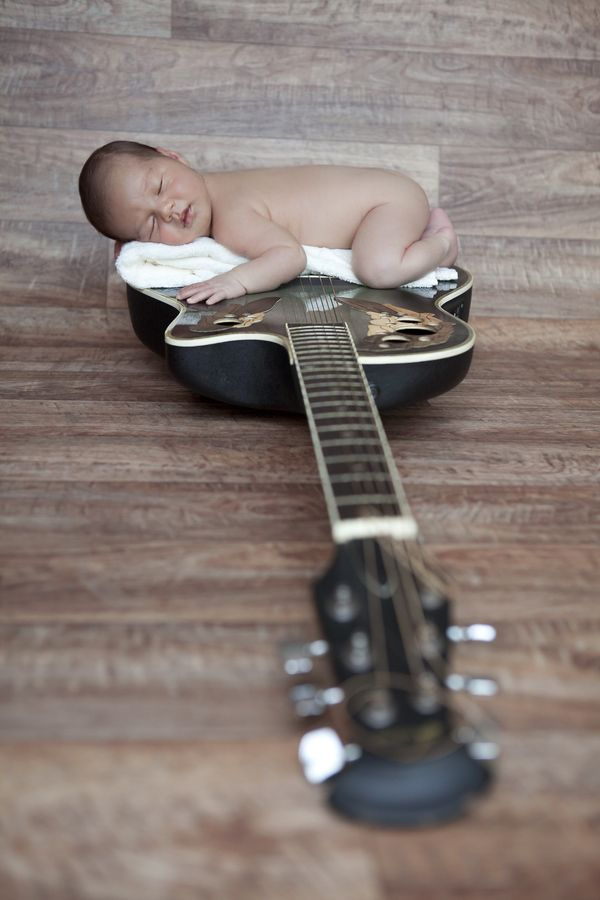 A little future rocker! The only thing that I would change about this pic is the color of the towel underneath the baby. Maybe a brown or black would blend in a lot better.