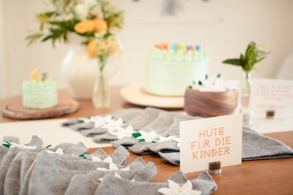 Wolfie's Austrian 1st birthday by Mein Schatz Events | The Long Haul Photo | 100 Layer Cakelet - Edelweiss hat party favors