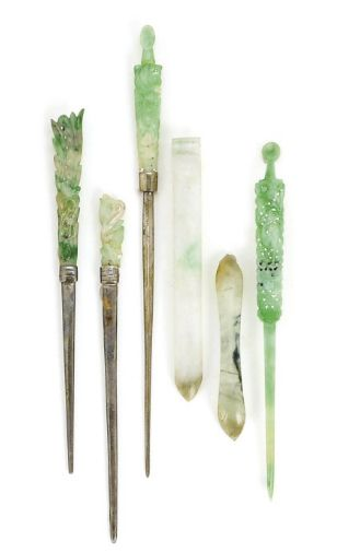 FOUR CHINESE JADEITE HAIR PINS AND TWO IMPLEMENTS,  LATE 19TH/20TH CENTURY,  three of the hair ornaments mounted with silvered metal, one with a silvered metal repair. The largest silvered metal-mounted hair pin 8in.