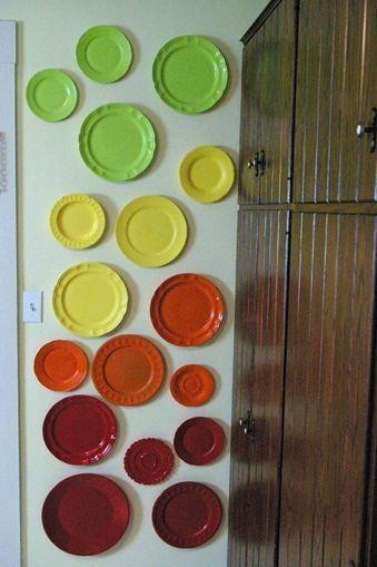 cheap plates + spray paint.  This could be a good idea for cheaply adding color above our cabinets! Decorative plates are SO expensive!