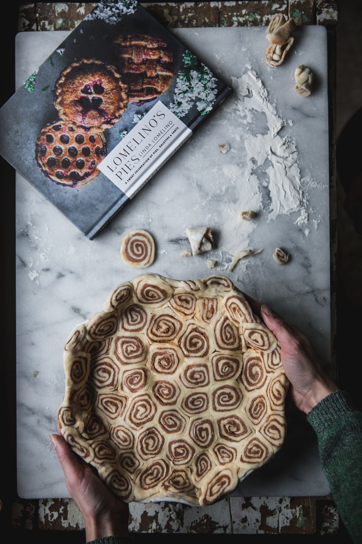 Cinnamon Roll Pie with Apples from Lomelino's Pies https://adventuresincooking.com/cinnamon-roll-pie-apples-lomelinos-pies/