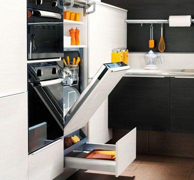 Le lave-vaisselle à hauteur - Plus question de se baisser pour remplir ou vider le lave-vaisselle ! On n'hésite pas à le surélever sur un socle de rangement, ce qui en facilite grandement l'usage. En version mini, il peut s'intégrer dans des éléments muraux et alléger ainsi l'espace. Entre deux placards. Intégré dans un élément demi-colonne, ce lave-vaisselle est encadré d'espaces de rangement.
