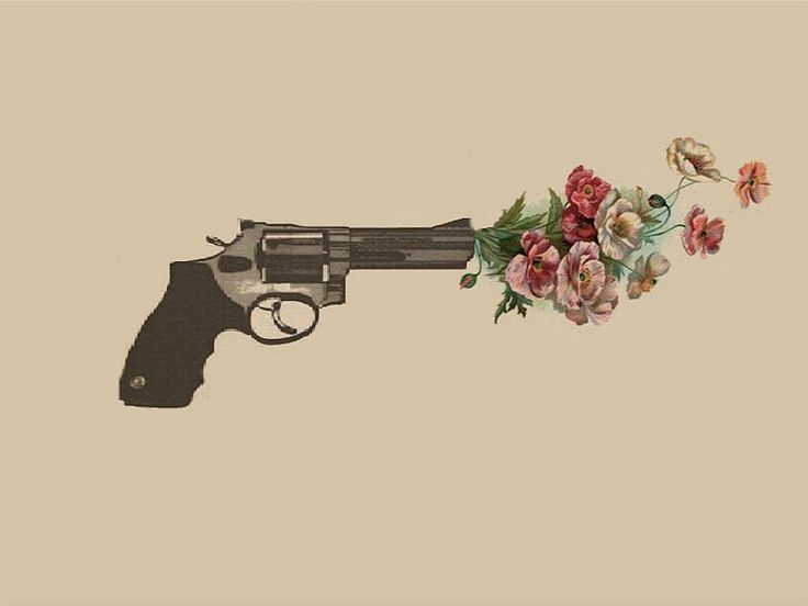 gun shooting out flowers tattoo idea