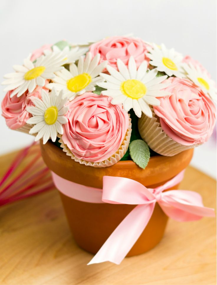 Mothers love flowers. We love our mothers. Everyone loves cupcakes. Do you see where I am going with this? Creating a cupcake bouquet couldn't be easier or cuter. All you need is the right tools and a simple tutorial to follow and voilà, you can now consider yourself your mother's favorite child!