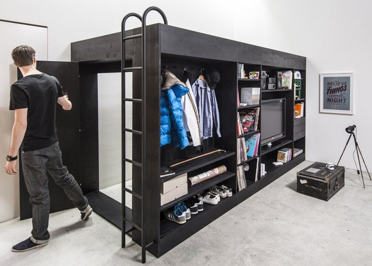 This space efficient box creates a separate sleeping area for Studio apartment solutions