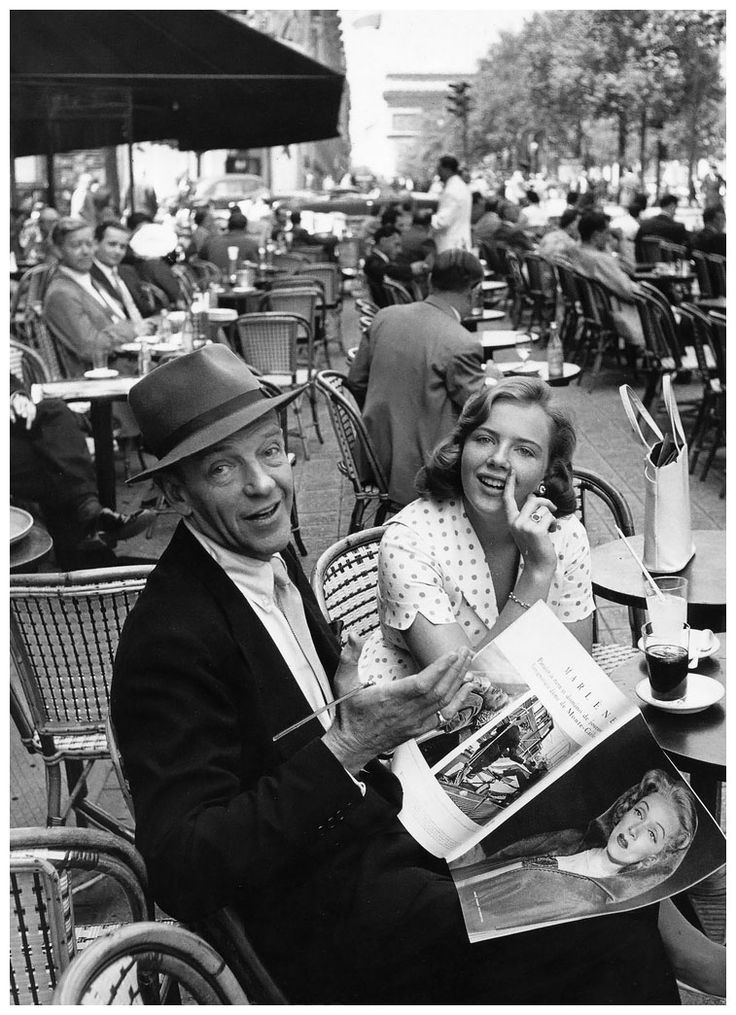 Fred Astaire sitting with his daughter, Ava, sitting at Fouquets on the Champs-Élysées, Paris, 1961. Photo by Willy Rizzo.