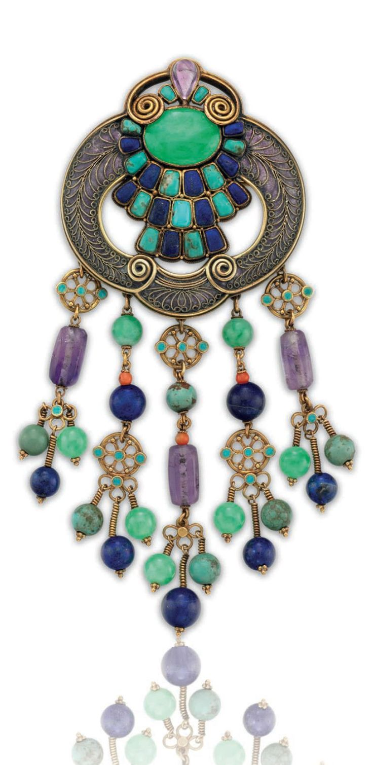 LOUIS COMFORT TIFFANY, TIFFANY & CO. - A MULTI-GEM, ENAMEL AND GOLD BROOCH, CIRCA 1920. Set with jades, amethysts, turquoises and lapis lazuli, mounted in gold. 4 ins. Signed Tiffany & Co. #LouisComfortTiffany