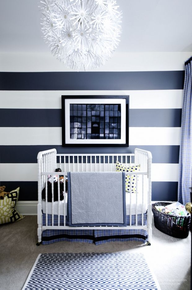 Ignoring the crib, that bold stripe and whimsical light fixture are brilliant together. Meredith Heron Design- Photo credit Stephani Buchman